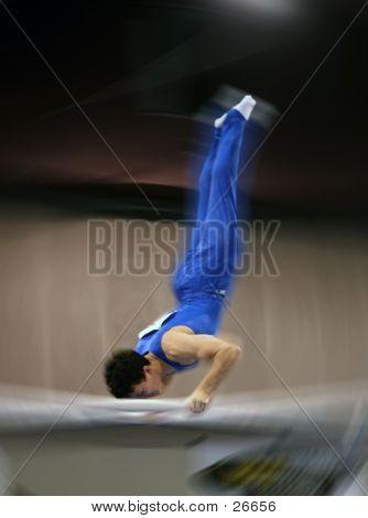 Blur Of A Gymnast On Parallel Bar