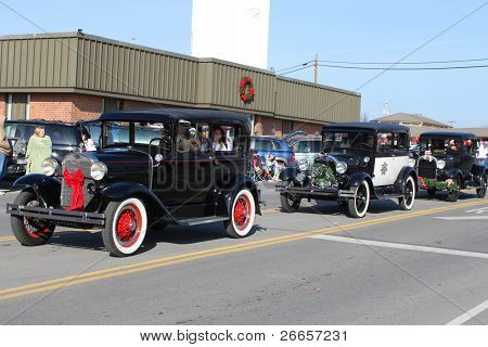 BROKEN ARROW, OK-DECEMBER 4: Dozens of vintage cars and trucks ride during the Broken Arrow Christmas Parade on December 4, 2010.