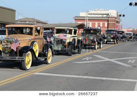 BROKEN ARROW, OK-DECEMBER 4: Dozens of vintage cars and trucks ride during the Broken Arrow Christmas Parade on December 4, 2010.