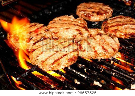 Hamburger patties on grill