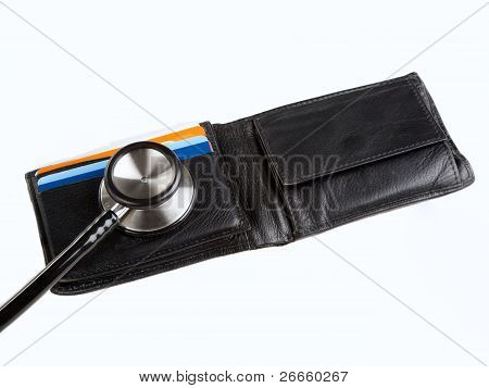 Stethoscope on credit cards in a wallet