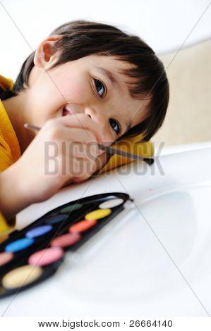 Cute kid painting