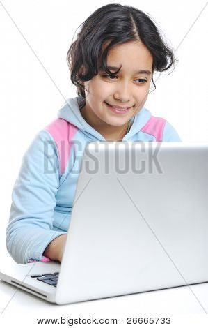 Beautiful little girl sitting with a laptop