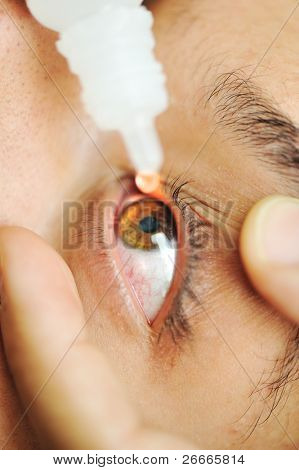 man sick with eye drops, hospital doctor examination