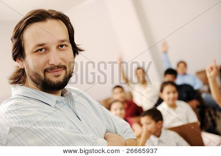 Group of preschool kids and their teacher in classroom, school, education concept