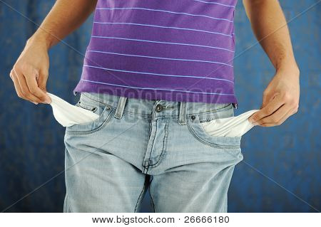 close-up of the hand of a man showing the pocket of his pants empty