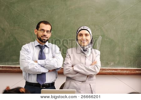 classroom with two muslim arabic teachers, male and female