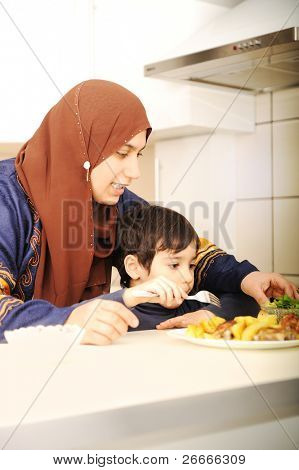 Portrait of young mother and her son having lunch together