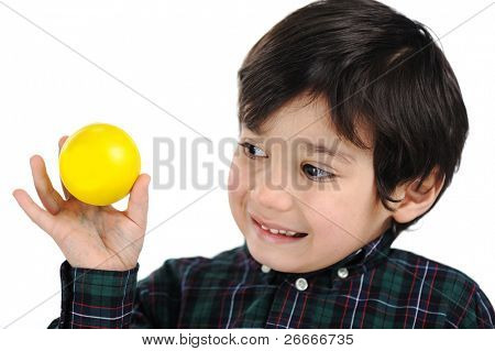 Happy beautiful kid boy with funny face and ball in his hand