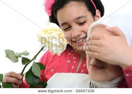 little kid girl is giving her mother a beautiful flower