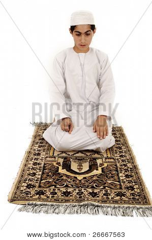 Arabic Muslim kid showing Islamic prayer