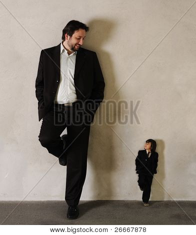 Two businessmen - Very very big and very small