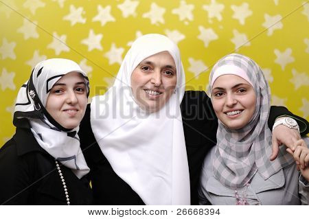 Arabic Muslim mother with two teen girls