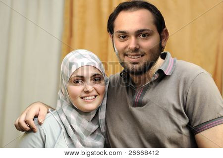 Happy Arabic couple indoor