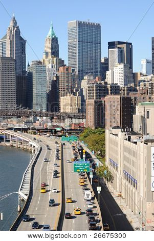 FDR Highway along the East River leading into numerous Manhattan skyscrapers in New York City.