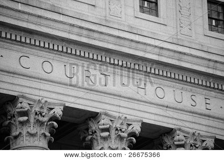 Marble courthouse building facade in black and white.