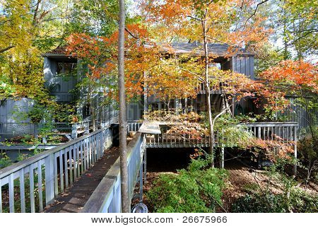 Porch and deck at the back of a house.