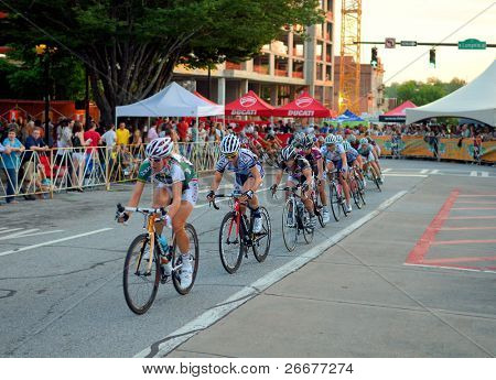 ATHENS, GEORGIA - MAY 30: Cyclists round a turn in Athens Twilight Criterium, the first nighttime race in the United States May 30, 2011 in Athens, GA.