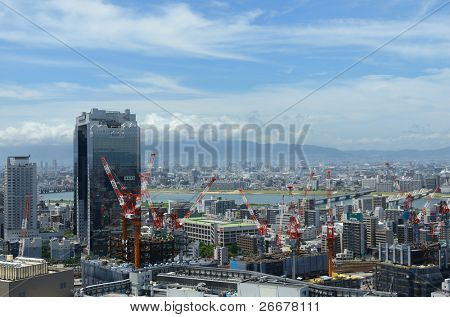 OSAKA, JAPAN - JULY 9: Umeda skyline on July 9, 2011 in Osaka, Japan. Umeda is the main commercial and central business district of Osaka and is currently under rapid development.