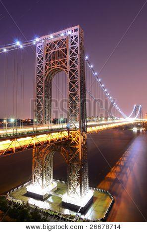 The George Washington Bridge spanning the Hudson River at twilight in New York City.