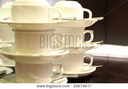 Stacked coffee cups with saucers