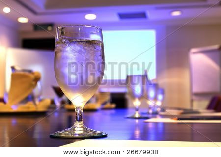 Beautiful goblets on a table at a meeting room