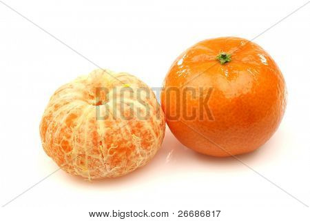 on whole and one peeled tangerine
