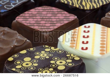 close up of assorted decorated luxury chocolate bonbons
