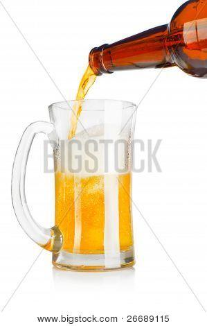 Beer Pouring Into A Mug