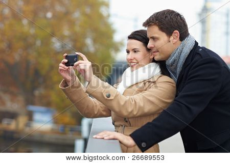 Tourists Taking Photos With Smartphone