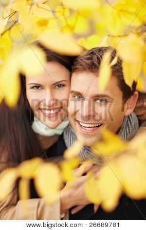 Happy Couple In Fall Forest