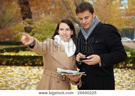 Tourists With Smartphone And City Map