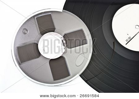 old dusty scratched vinyl record and audio reel tape