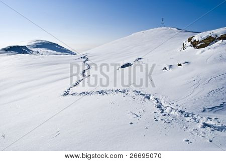 Snow mountain.Winter panorama.Traces