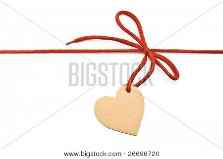 "Red shoelace,bow with cardboard tag ""heart"""