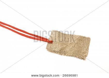 Red shoelace with sackcloth tag