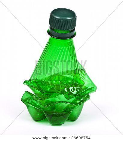 Squashed plastic green bottle