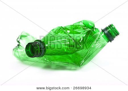 Squashed plastic green bottles