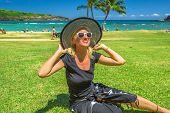 Woman Relaxing In Hanauma Bay Nature Preserve, Oahu, Hawaii, Usa. Smiling Female In Black Beachwear, poster