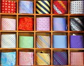 Ties on the shelf of a shop in Como region, Italy