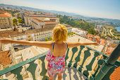 Happy Tourist Woman With Open Arms Admiring Coimbra Panorama From Top Of Bell Clock Tower. Female To poster