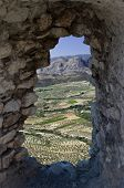 aerial landscaped through a hole in the wall from Acrocorinth a monolithic rock overseeing the ancie