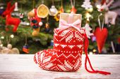 Wrapped Gift For Christmas In Red Sock And Christmas Tree With Decoration, Festive Time poster