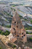several 'pigeon house' carved in typical rock formation in Cappadocia, Turkey; the local farmers hav
