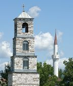 pic of coexist  - belltower of orthodox church and minaret of musulman mosque in republic of Macedonia  - JPG