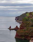 View Of The Rocky South Devon Coast Near Teignmouth, England Under An Overcast Sky poster