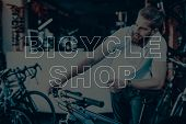 Bicycle Shop. Man Using The Bicycle. Guy Checks The Bike. Man Looking On His Bicycle. Young Beard Ma poster