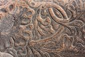picture of western saddle  - Leather design on a saddle closeup - JPG