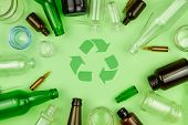 Green Recycle Sign Symbol With Glass Trash Garbage Bottle, Pills And Tubes On Green Isolated Backgro poster