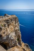 Small Part Of Ancient Lindos Acropolis Above High Reef On Rhodes Island poster